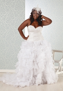 Ball gowns are very flattering on the waist. They make the waist appear smaller, and if you have wide hips it will not draw attention to them.