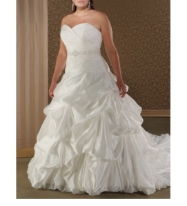 """On this ball gown the waist is brought a little further down on the dress. This cut is referred to as the """"natural waistline"""". The natural waistlines shows off more of your waist and causes your torso to look longer and leaner."""