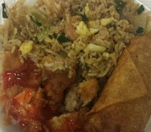 Yummy Shrimp Fried Rice, Sweet and Sour Chicken (your choice of dark or white meat), and an egg roll the size of a borrito
